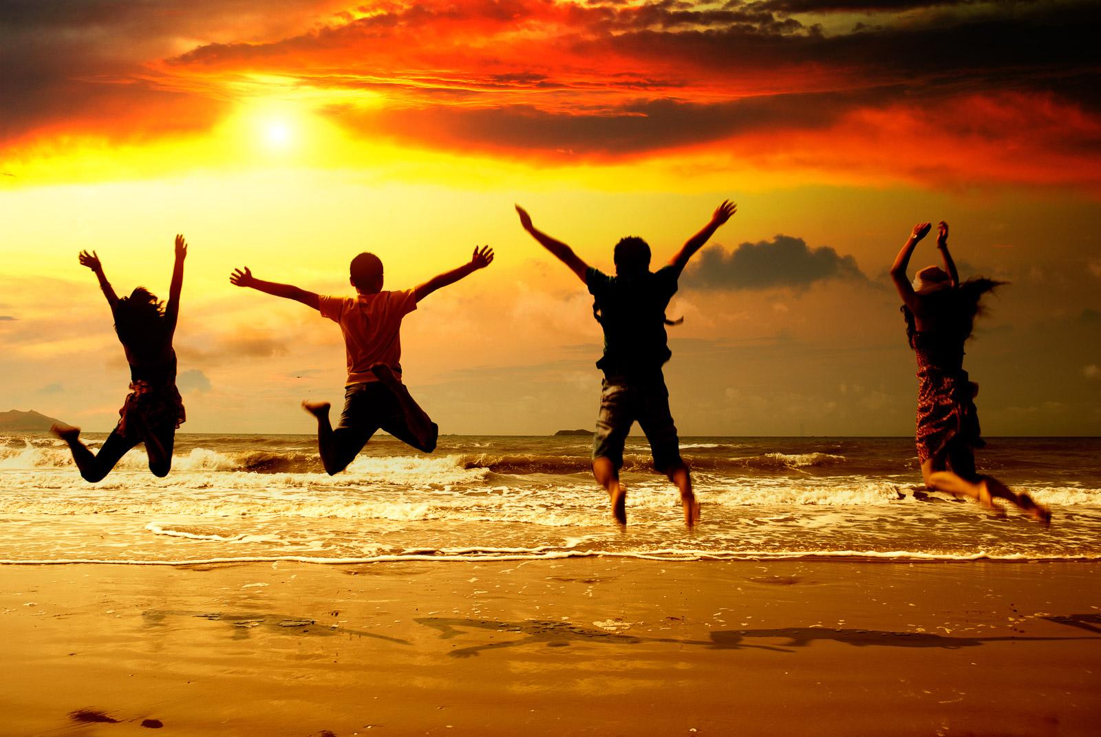 family jumping seashore beach