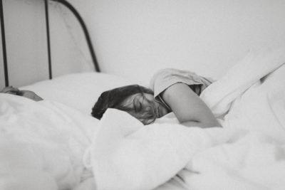 woman sleeping bw unsplash 1
